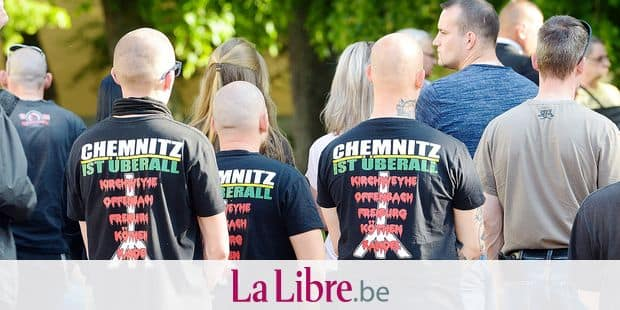 "19 May 2019, Saxony-Anhalt, Köthen: Three participants of a demonstration of the right-wing scene are standing with their shirts with the inscription ""Chemnitz is everywhere"" in the city centre. After the verdict in the trial for the death of a young man, rights and counter-demonstrators took to the streets in Köthen. About 180 participants of a right-wing spontaneous demonstration went on Sunday towards the scene of the crime where a 22-year-old man had died in September. Photo: Heiko Rebsch/dpa Reporters / DPA"