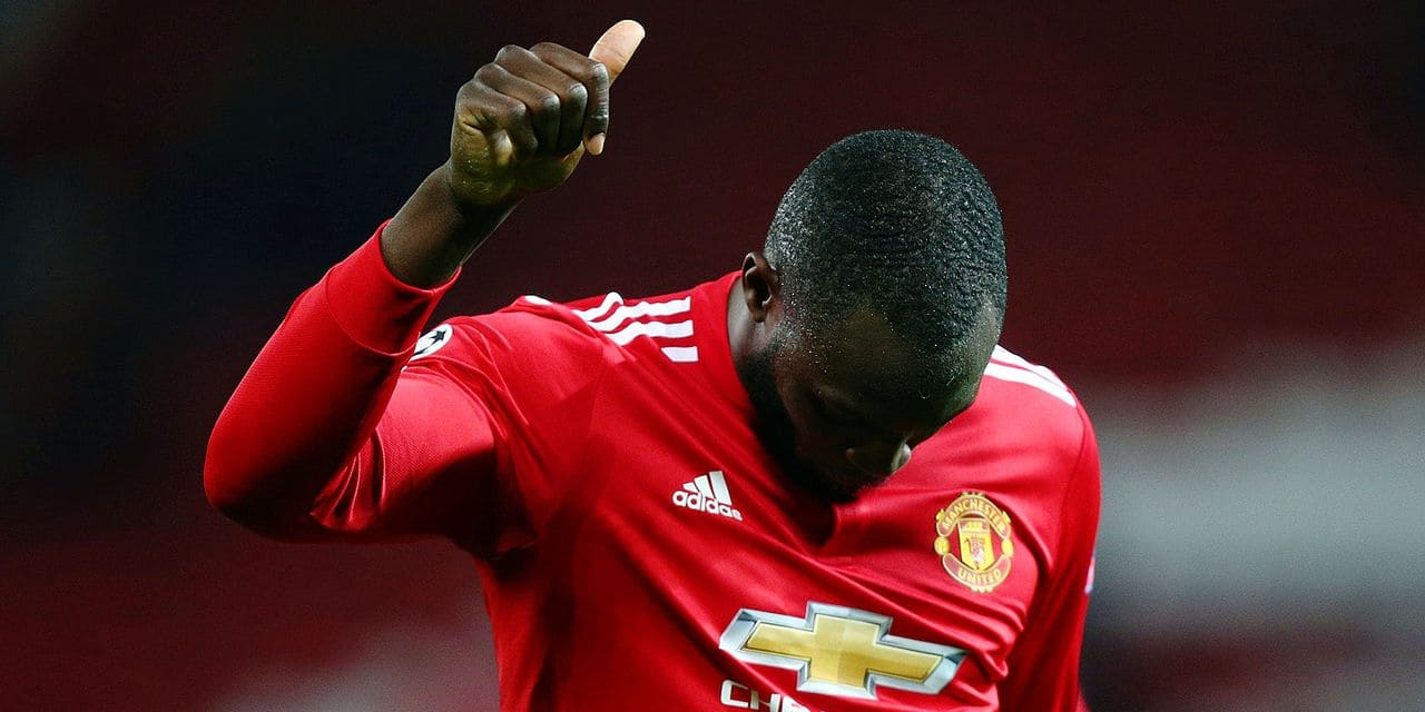 Manchester United's Romelu Lukaku gestures to the crown as he walks from the pitch after the end of the Champions League round of 16 second leg soccer match between Manchester United and Sevilla, at Old Trafford in Manchester, England, Tuesday, March 13, 2018. Sevilla won the game 2-1 and go through to the quarterfinals .(AP Photo/Dave Thompson)