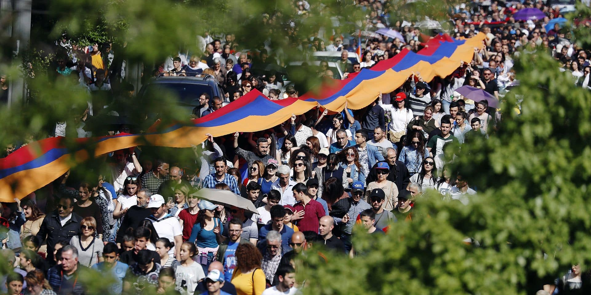 Yerevan, Armenia – April 24, 2018: A huge Armenian national flag seen during an event to commemorate the victims of the early 20th century Armenian genocide in the Ottoman Empire. Photo by Artyom Geodakyan/TASS/ABACAPRESS.COM