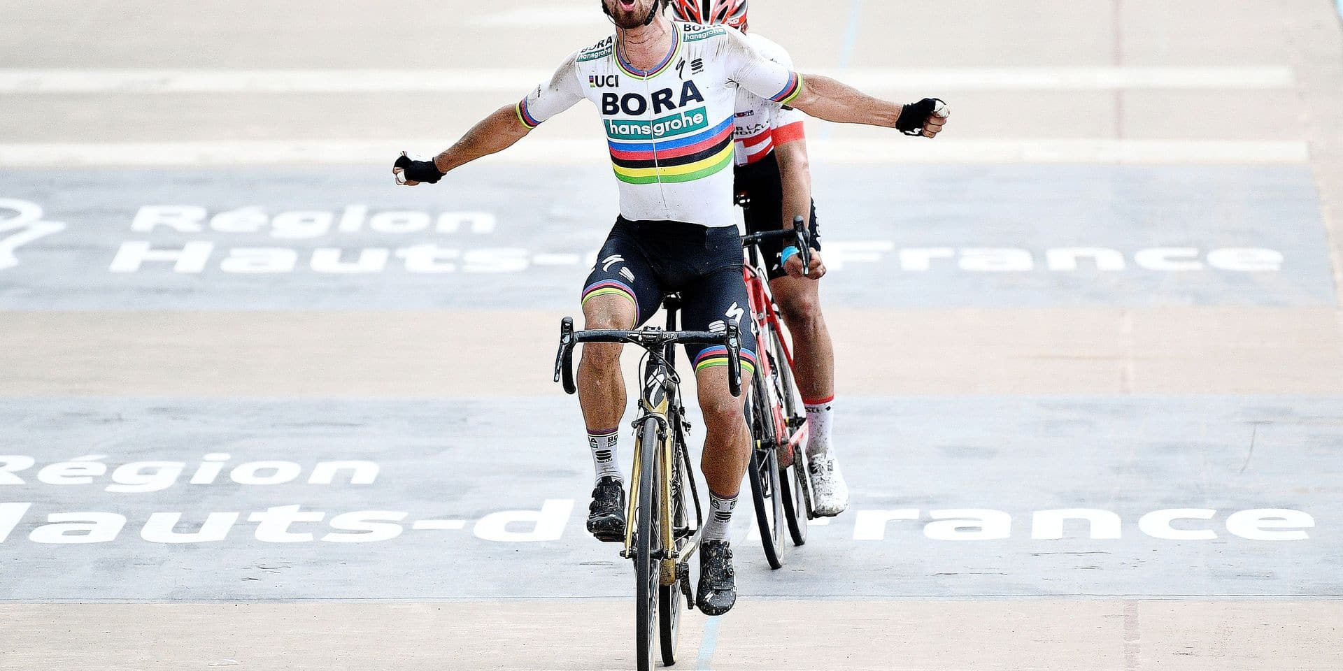 Slovakian Peter Sagan of Bora-Hansgrohe (front) celebrates as he wins before Swiss Silvan Dillier of AG2R La Mondiale (rear) the sprint at the finish of the 116th edition of the 'Paris-Roubaix' one day cycling race, from Compiegne, near Paris to Roubaix. BELGA PHOTO YORICK JANSENS