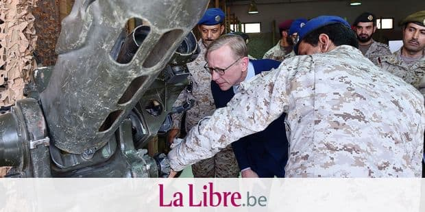 "Brian Hook (C), the US special representative on Iran, listens to a Saudi official as they check what Saudi officials said was an Iranian-made launcher used by the Huthi rebels in Yemen, during a visit to an army base in al-Kharj, south of the Saudi capital Riyadh, on June 21, 2019. - The US said Iran has no right to respond to diplomacy ""with military force"", a day after Washington said Tehran shot down a US drone over the Strait of Hormuz. ""Our diplomacy does not give Iran the right to respond with military force,"" Hook, told reporters in Saudi Arabia. (Photo by Fayez WEHBE / AFP)"