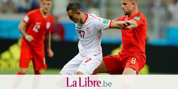 England's Jordan Henderson compete for the ball Tunisia's Ellyes Skhiri during the group G match between Tunisia and England at the 2018 soccer World Cup in the Volgograd Arena in Volgograd, Russia, Monday, June 18, 2018. (AP Photo/Alastair Grant)
