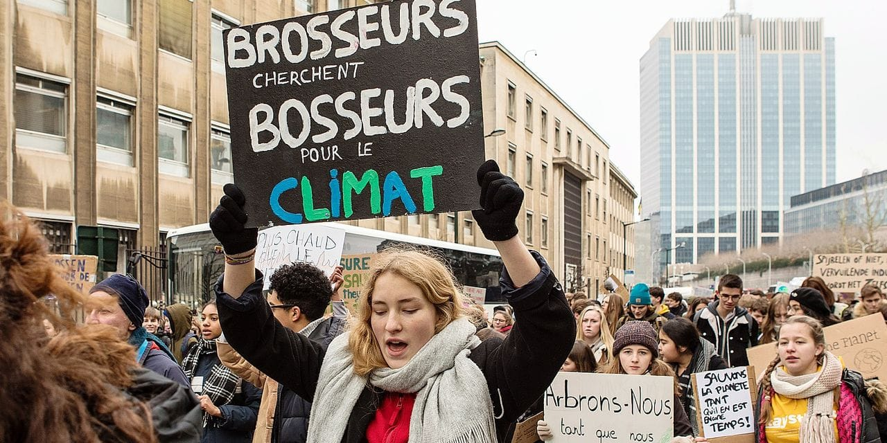 Illustration shows a message saying 'Brosseurs cherchent bosseurs pour le climat' at a student strike action, organized by 'Youth For Climate', urging pupils to skip classes to protest a lack of climate awareness, Thursday 31 January 2019 in Brussels. This marks the fourth consecutive week youths take the streets on Thursday. BELGA PHOTO PAUL-HENRI VERLOOY