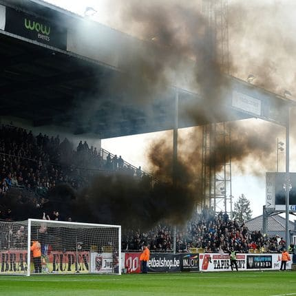 Black smoke rises from the stans with Eupen supporters during the Jupiler Pro League match between KAS Eupen and Royal Excel Mouscron, in Eupen, Sunday 11 March 2018, on day 30 of the Jupiler Pro League, the Belgian soccer championship season 2017-2018. BELGA PHOTO JOHN THYS