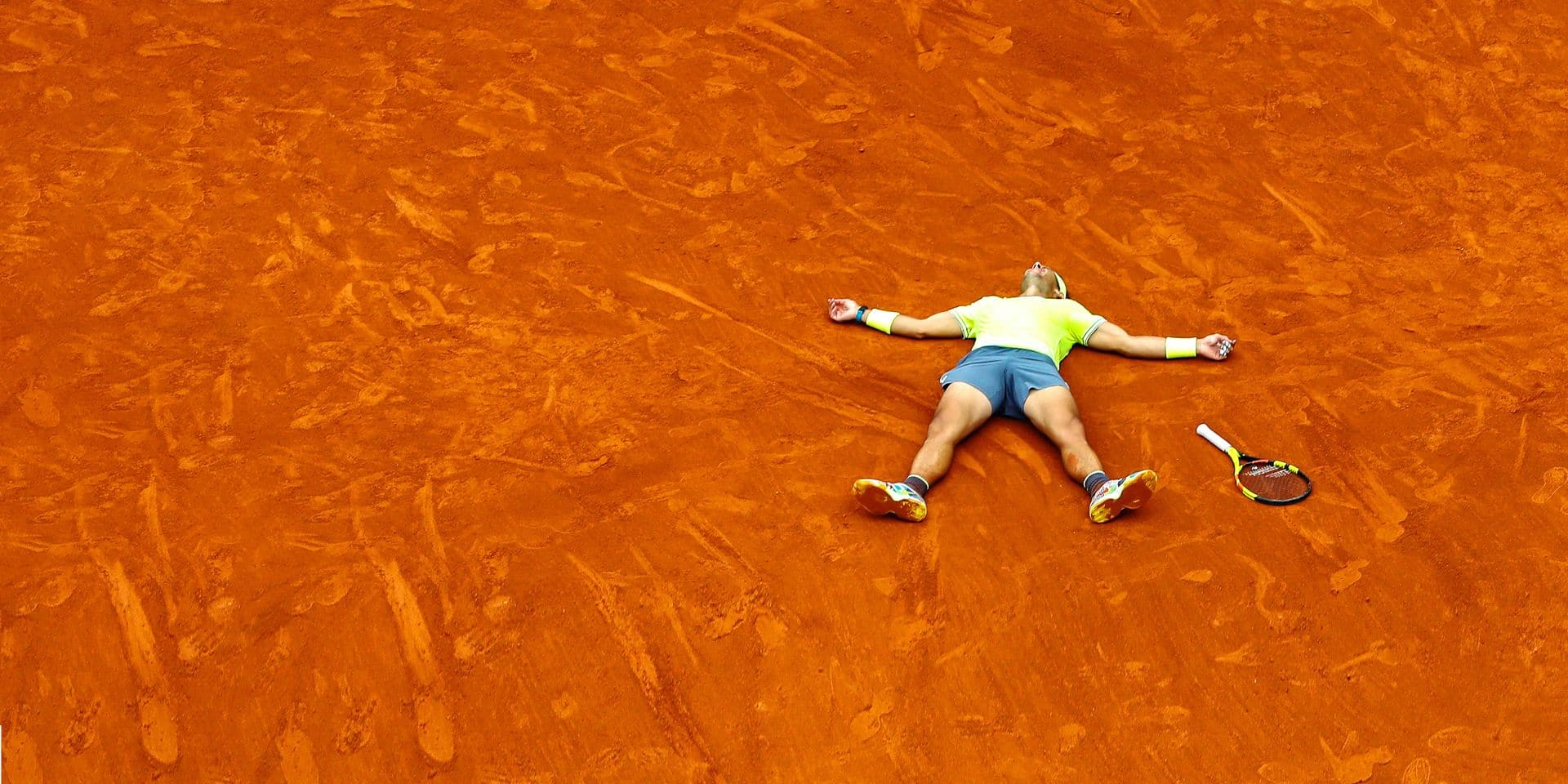 Spain's Rafael Nadal celebrates his record 12th French Open tennis tournament title after winning his men's final match against Austria's Dominic Thiem in four sets, 6-3, 5-7, 6-1, 6-1, at the Roland Garros stadium in Paris, Sunday, June 9, 2019. (AP Photo/Pavel Golovkin)