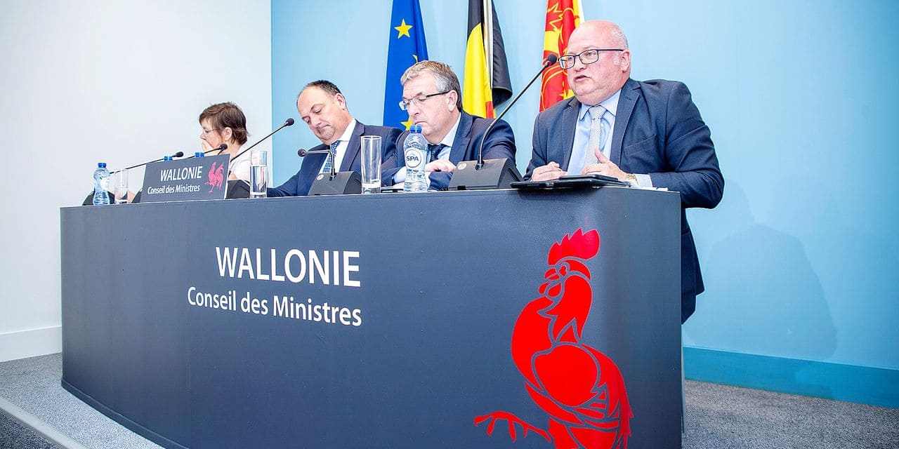 Walloon vice-minister president and minister of Social Action, Health, Equal Chances, Public Function and Administrative Simplification Alda Greoli, Walloon Minister President Willy Borsus, Walloon vice-minister president and minister of Economy, Employment and Formation Pierre-Yves Jeholet and Walloon minister of Budget, Energy and Airports Jean-Luc Crucke pictured during a press conference following an agreement on the budget 2018 of the Walloon Government in Jambes, Namur, Friday 18 May 2018. BELGA PHOTO HATIM KAGHAT