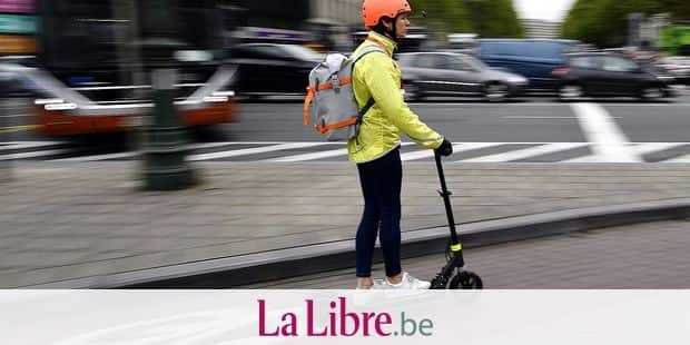 Illustration picture shows the a person riding an electric moped scooter in Brussels, Friday 03 May 2019. BELGA PHOTO ERIC LALMAND