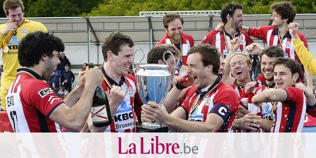 Leopold's players celebrate with the trophy after winning a hockey game between Royal Leopold Club and Royal Beerschot Hockey Club, the return leg of the finals of the play-offs of the men's 'Audi league' Belgian hockey competition, Sunday 12 May 2019 in Lier. BELGA PHOTO JOHN THYS