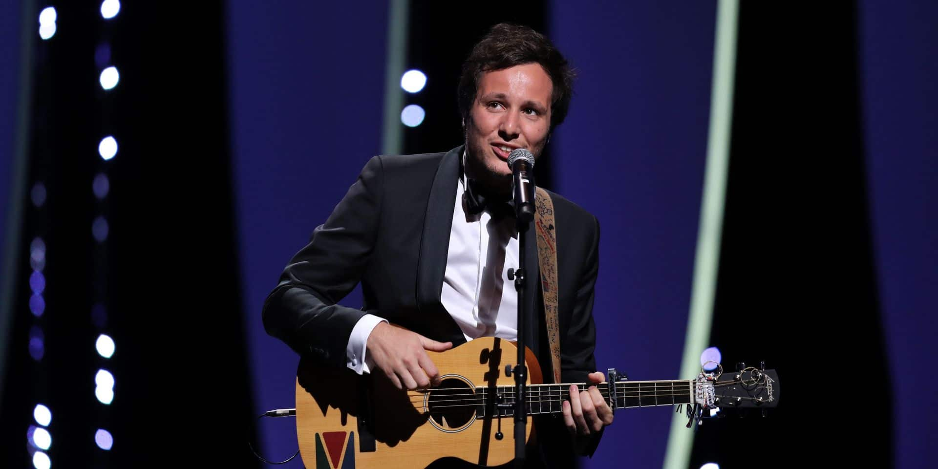 """(FILES) In this file photo taken on May 23, 2017 French singer/songwriter Vianney performs on stage during the '70th Anniversary' ceremony of the Cannes Film Festival in Cannes, southern France. - """"Les Enfoires"""" will perform five concerts at the Arkea Area in Bordeaux, from January 24 to January 28, 2019, to celebrate the 30 years of the musical show, with a new song written by Vianney. (Photo by Valery HACHE / AFP)"""