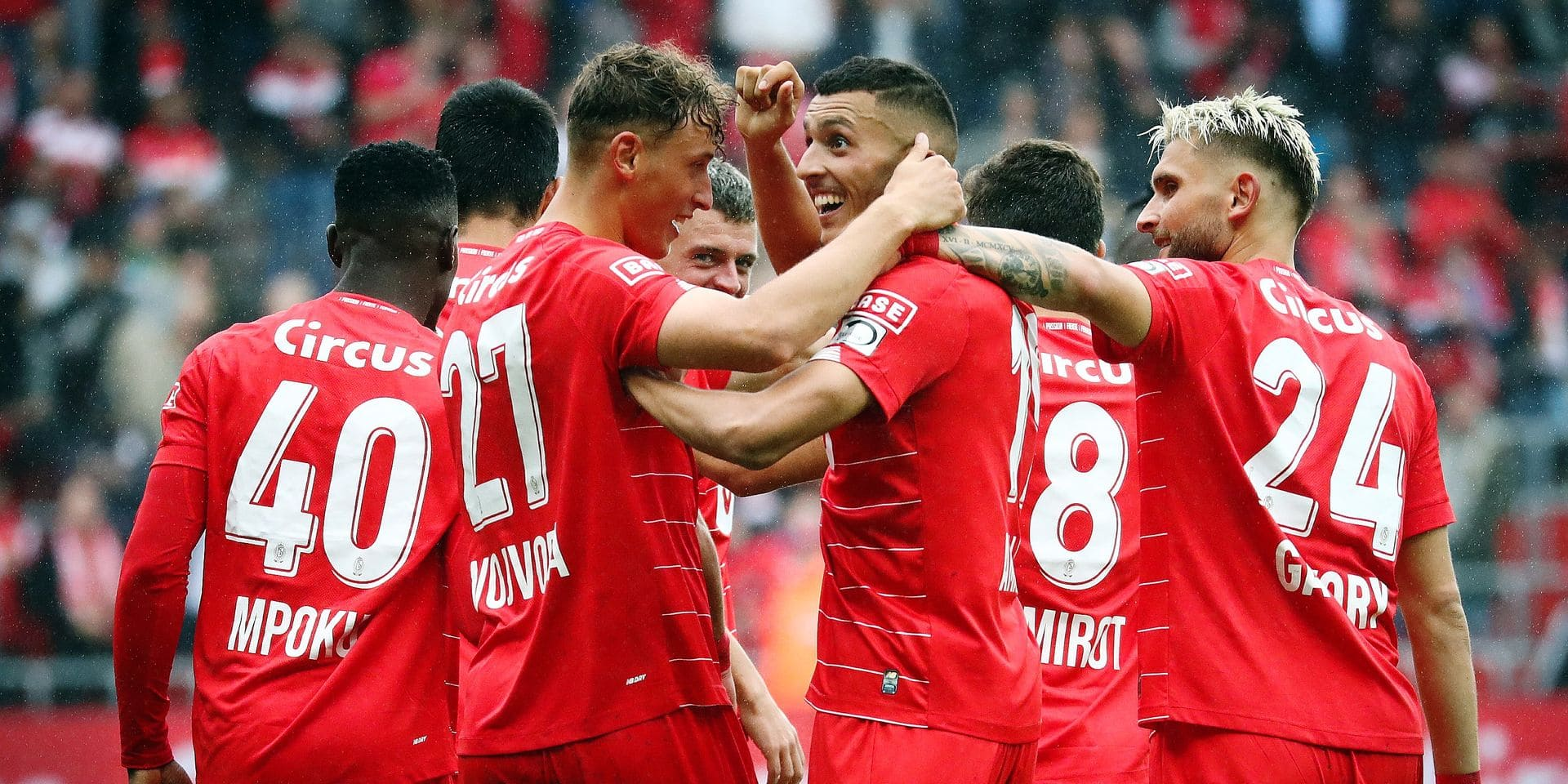 Standard's Selim Amallah (C) celebrates with his teammates after scoring during a soccer match between Standard de Liege and Excel Mouscron, Sunday 18 August 2019 in Liege, on the fourth day of the 'Jupiler Pro League' Belgian soccer championship season 2019-2020. BELGA PHOTO VIRGINIE LEFOUR