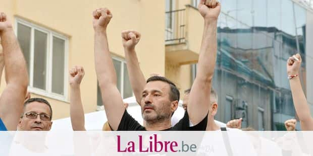 FILE - In this Thursday, May 3, 2018 file photo Davor Dragicevic, father of late David Dragicevic, 21, gestures during protest in the Bosnian town of Banja Luka, 260 kms northwest of Sarajevo, Bosnia. Serb lawmakers are discussing security in their mini-state in Bosnia after the suspicious death of a student triggered daily protests and cover-up accusations against top police officials. (AP Photo/Radivoje Pavicic, File)