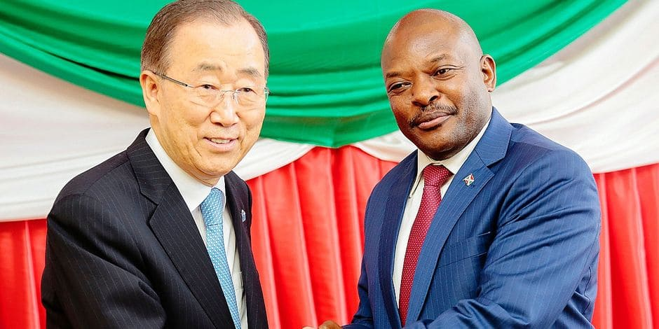 U.N. Secretary General Ban Ki-moon, left, and Burundi's President Pierre Nkurunziza pose for photographers during a meeting in Bujumbura, Burundi. Tuesday, Feb. 23, 2016. Ban is in Burundi to encourage dialogue between the government and its opponents amid violent unrest. (AP Photo)
