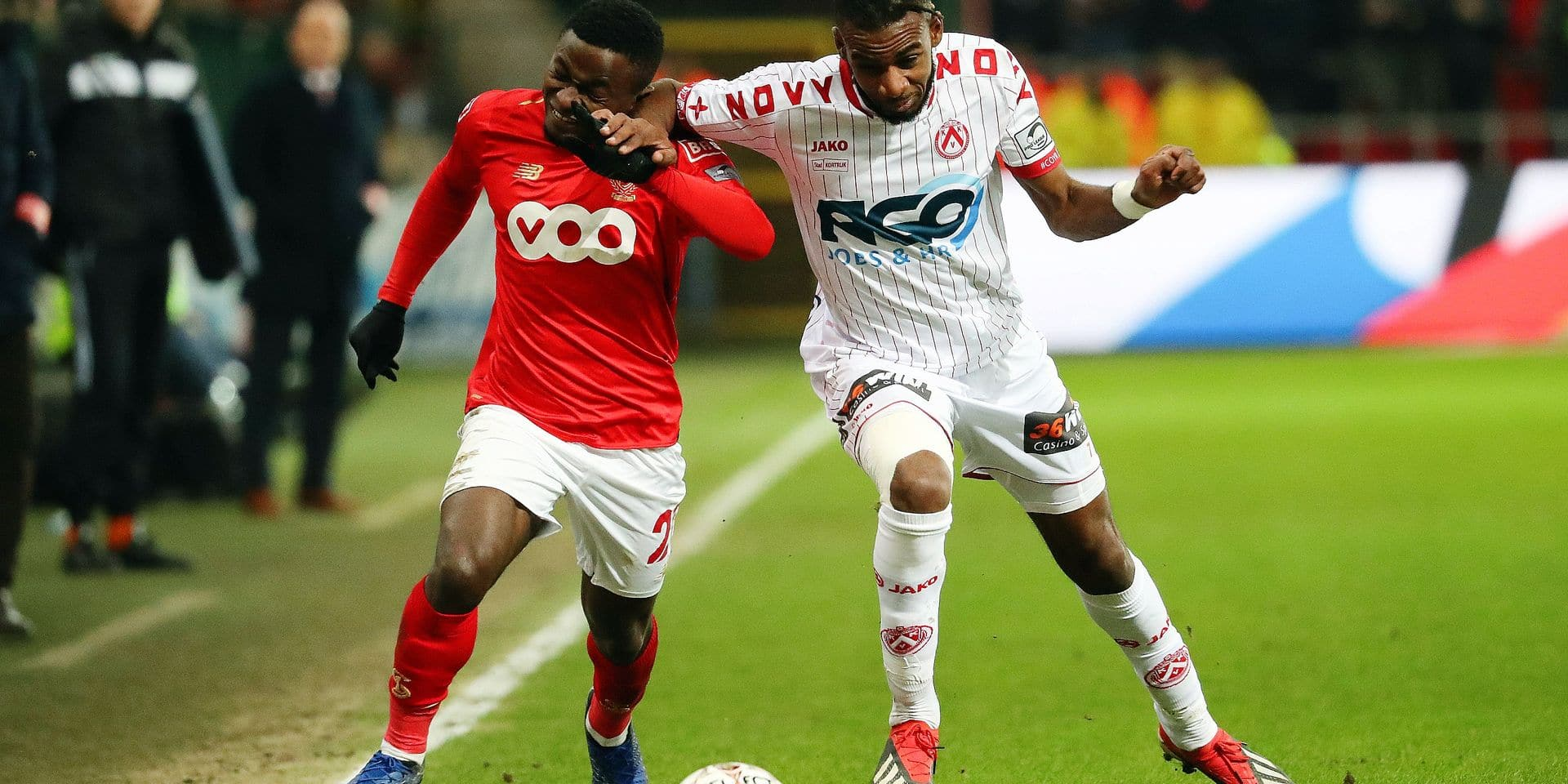 Standard's Collins Fai and Kortrijk's Ilombe 'Petit Pele' Mboyo fight for the ball during a soccer match between Standard de Liege and KV Kortrijk, Saturday 19 January 2019 in Liege, on day 22 of the 'Jupiler Pro League' Belgian soccer championship season 2018-2019. BELGA PHOTO VIRGINIE LEFOUR
