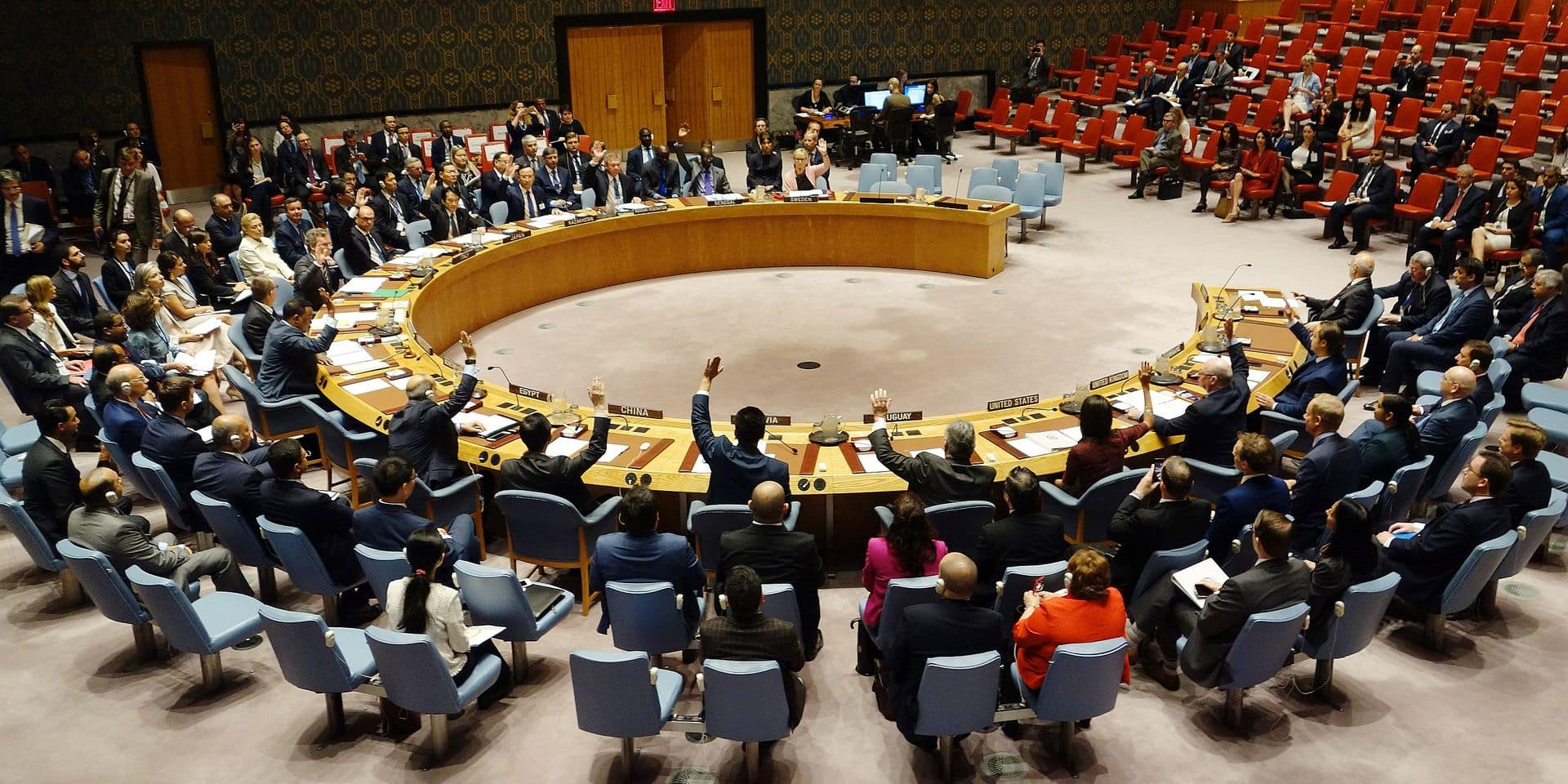 The United Nations Security Council votes at a meeting on threats to international peace and security September 21, 2017 at the United States Mission in New York. / AFP PHOTO / DON EMMERT