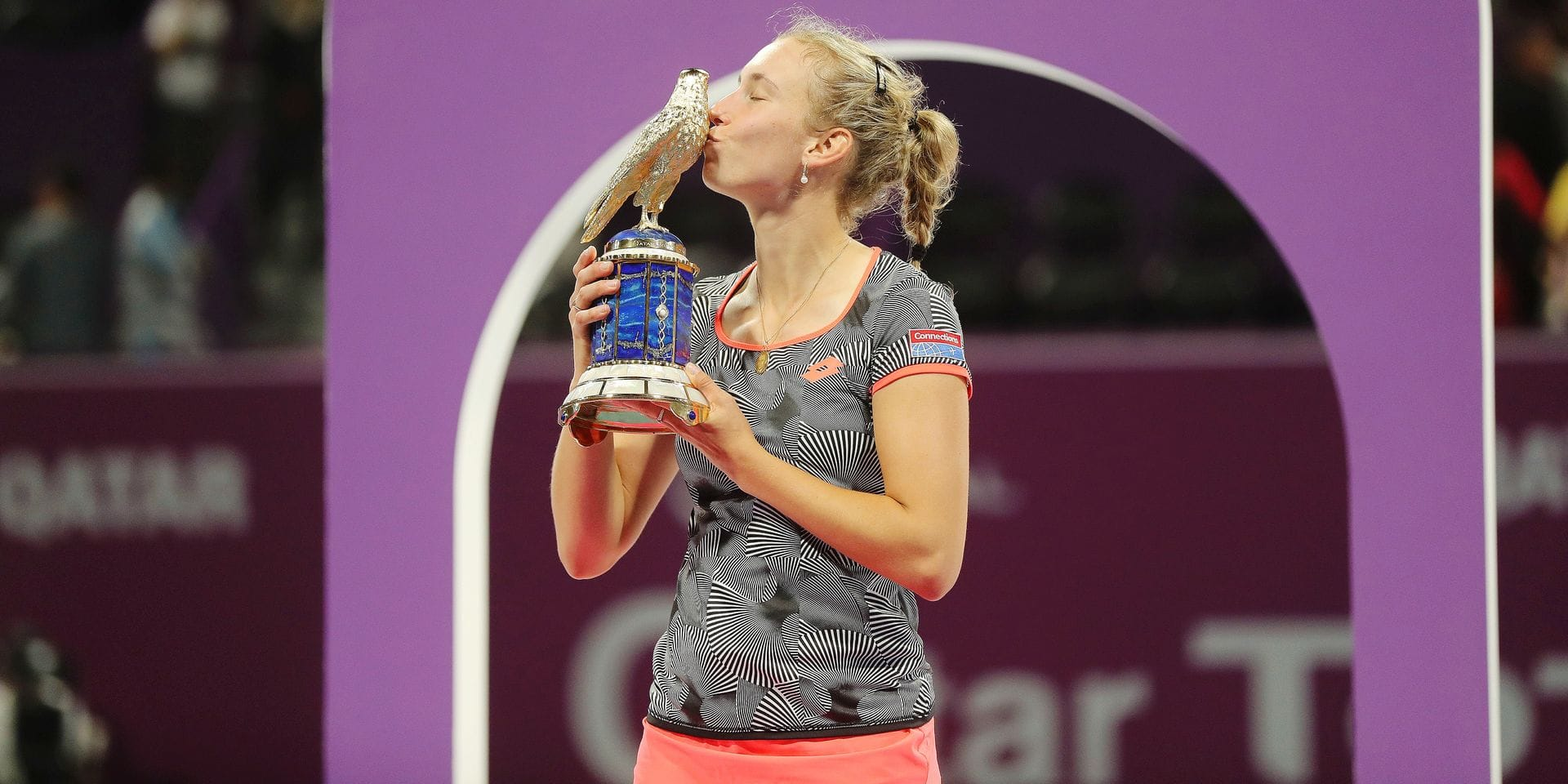 Belgian Elise Mertens kisses the trophy after her victory over Romanian Simona Halep in their WTA Qatar Open final tennis match in Doha on February 16, 2019. (Photo by KARIM JAAFAR / AFP)