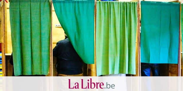 Marche-en-Famenne , 14/10/18 Belgium votes in municipal, district and provincial elections. Rene Collin and Willy Borsus cast their vote at a polling station in Marche-en-Famenne. Pix : Vote Illustration Credit : Daina Le Lardic / Isopix