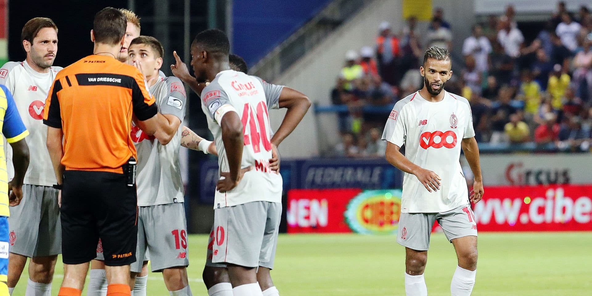 Standard's Mehdi Carcela receives a red card from the referee during the Jupiler Pro League match between Waasland-Beveren and Standard de Liege, in Beveren-Waas, Friday 03 August 2018, on the second day of the Jupiler Pro League, the Belgian soccer championship season 2018-2019. BELGA PHOTO VIRGINIE LEFOUR