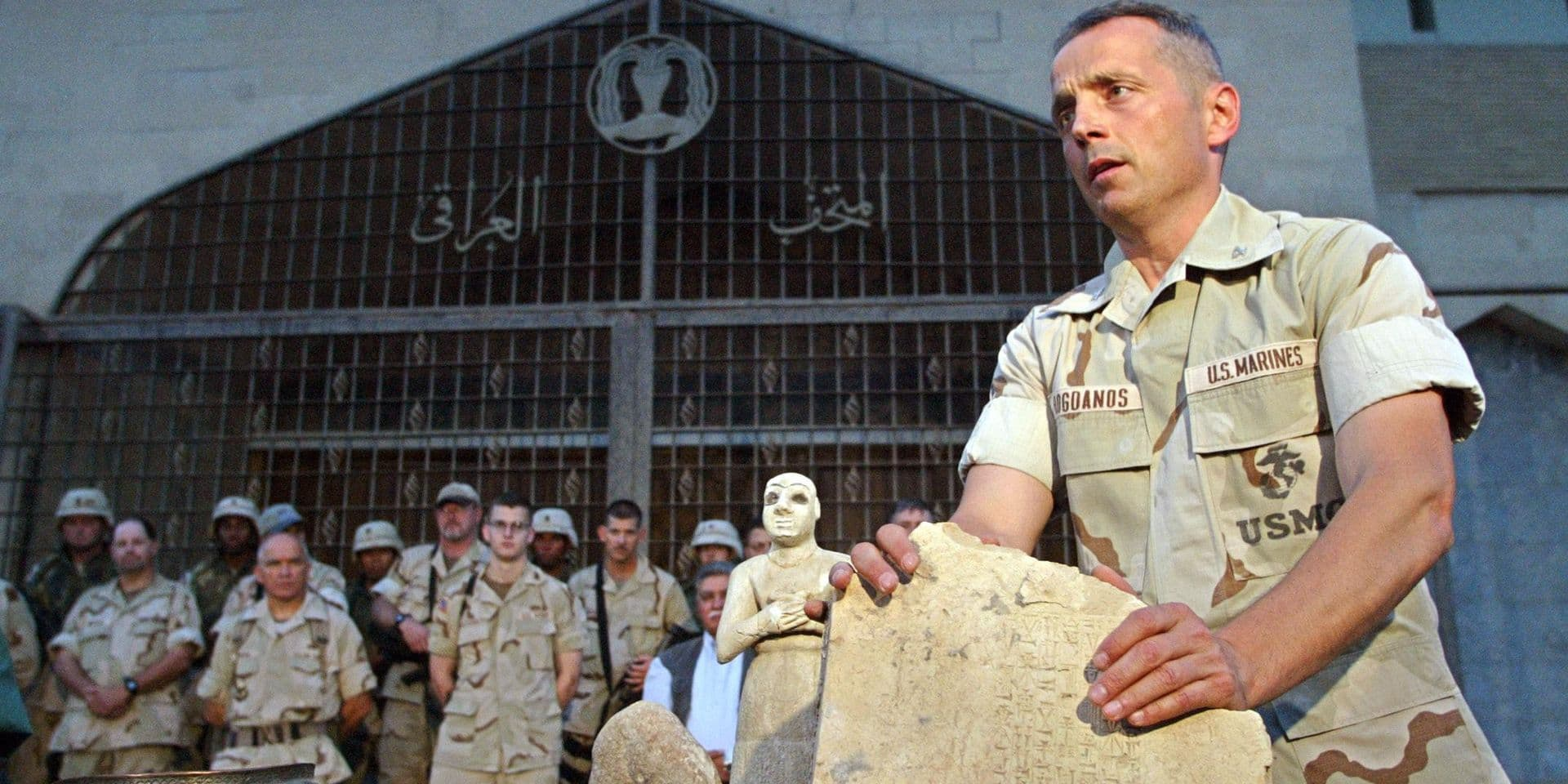 US Colonel Matthew Bogdanos, lead investigator in finding looted treasures taken from the Baghdad Archeological Museum, directs a presentation to the press in Baghdad, 16 May 2003. Investigators have recovered 951 artifacts and determined many items had been stored for their security in pre-war hidding sites. One of the oldest known bronze relief bowls, an Assiryan pottery jar from the sixth millenium B.C., one of the earliest known Sumerian free-standing statue and a carved rock from the Babilonic period were pesented to the press. AFP PHOTO/Behrouz MEHRI / AFP PHOTO / BEHROUZ MEHRI