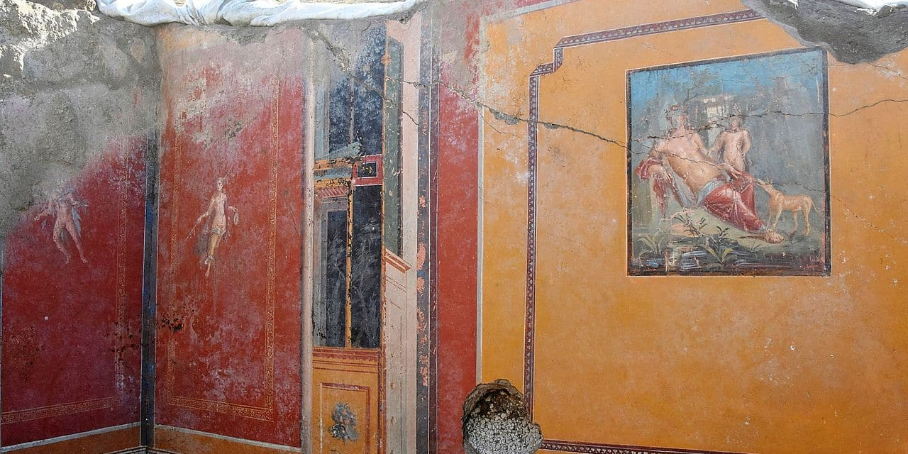 This undated photo provided Thursday, Feb. 14, 2019 by the Parco Archeologico di Pompei (Archeological Park of Pompei) shows the atrium of a house with a fresco portraying the mythological hunter Narcissus, right, in Pompeii, near Naples, Italy. Archaeologists have discovered a fresco in an ancient Pompeii residence that portrays the mythological hunter Narcissus, who fell in love with his own reflection, in a house where a fresco was found late last year depicting a sensual scene between the Roman god Jupiter disguised as a swan and Leda, a queen of Sparta from Greek mythology. (Parco Archeologico di Pompei via AP)