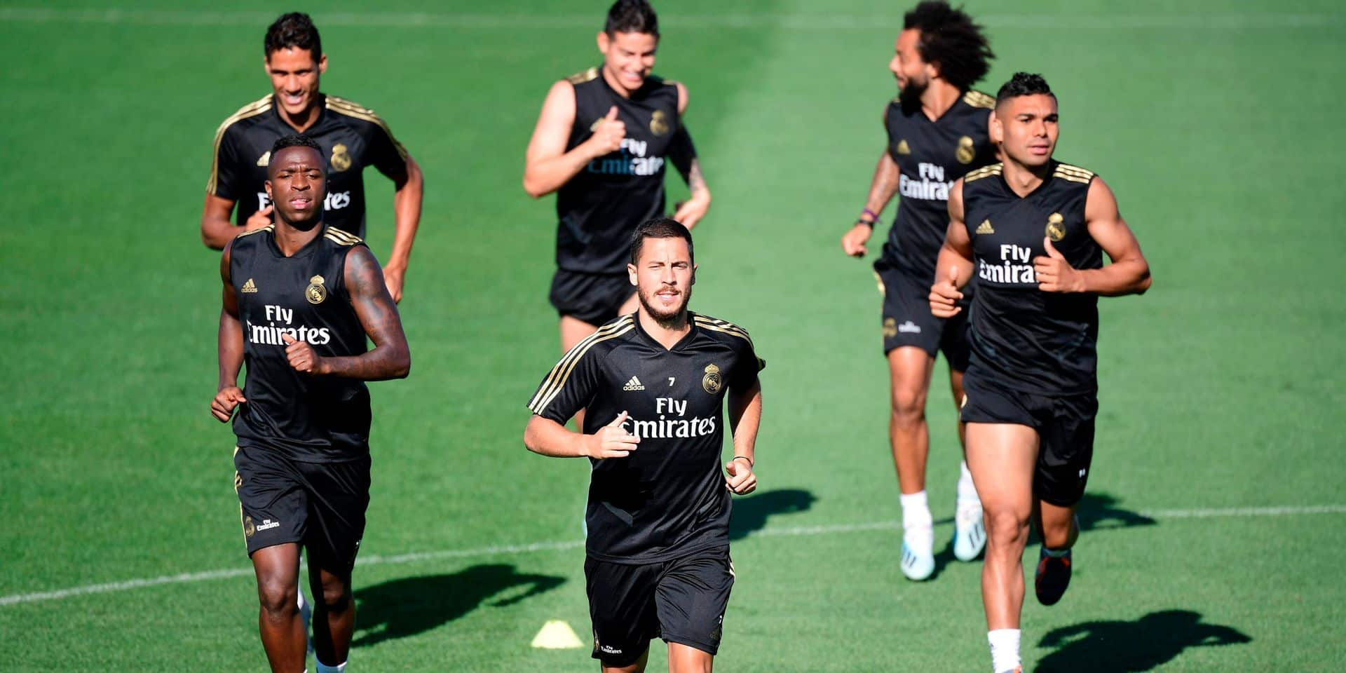 (FRONT L to R) Real Madrid's Brazilian forward Vinicius Junior, Real Madrid's Belgian forward Eden Hazard, Real Madrid's Brazilian midfielder Casemiro (BACK L to R) Real Madrid's French defender Raphael Varane, Real Madrid's Colombian midfielder James Rodriguez and Real Madrid's Brazilian defender Marcelo take part in a training session at Real Madrid's sport city in Madrid on August 16, 2019. (Photo by JAVIER SORIANO / AFP)