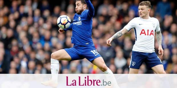 Chelsea's Eden Hazard, left, controls the ball in front of Tottenham's Kieran Trippier during the English Premier League soccer match between Chelsea and Tottenham Hotspur at Stamford Bridge stadium in London, Sunday, April 1, 2018. (AP Photo/Frank Augstein)