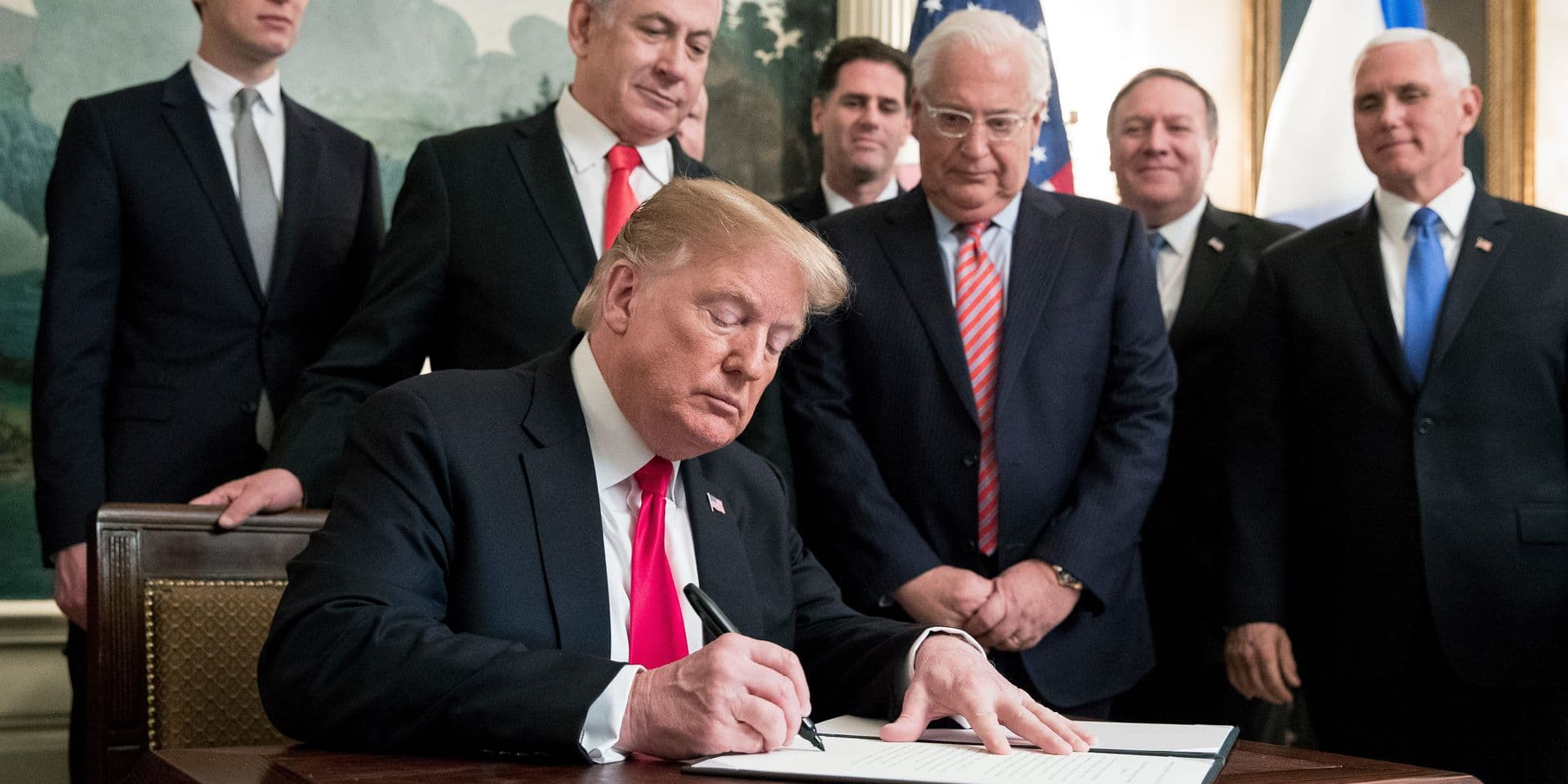 US President Donald J. Trump (C) signs an order recognizing Golan Heights as Israeli territory, in front of Prime Minister of Israel Benjamin Netanyahu (Back C), in the Diplomatic Reception Room of the White House in Washington, DC, USA, 25 March 2019. Also in the picture is Senior Advisor to the President Jared Kushner (Back L), US Ambassador to Israel David Friedman (3-R) and US Secretary of State Mike Pompeo (2-R) and US Vice President Mike Pence (R). Credit: Michael Reynolds / Pool via CNP | usage worldwide