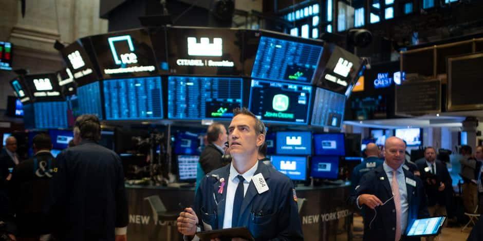 Les traders du parquet de Wall Street, maillons essentiels ou reliques du passé?