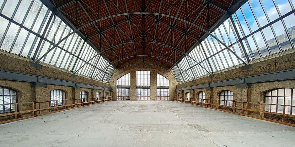 Le site est celui d'une ancienne centrale électrique de la rue Volta, derrière le Cimetière d'Ixelles.