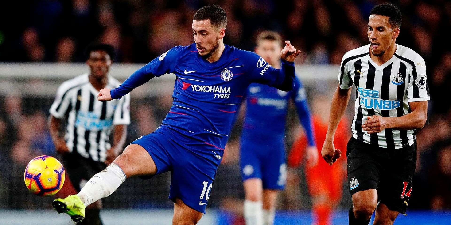 Chelsea's Belgian midfielder Eden Hazard (L) controls the ball during the English Premier League football match between Chelsea and Newcastle United at Stamford Bridge in London on January 12, 2019. (Photo by Adrian DENNIS / AFP) / RESTRICTED TO EDITORIAL USE. No use with unauthorized audio, video, data, fixture lists, club/league logos or 'live' services. Online in-match use limited to 120 images. An additional 40 images may be used in extra time. No video emulation. Social media in-match use limited to 120 images. An additional 40 images may be used in extra time. No use in betting publications, games or single club/league/player publications. /