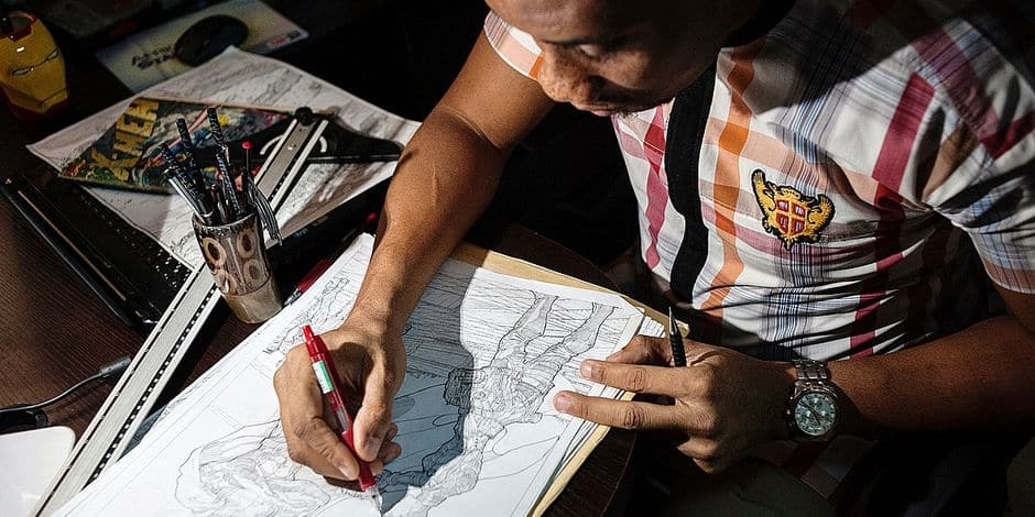 Founder of Comic Republic Jide Martins works on a sketch at the Comic Republic office in Lagos on January 8, 2016. Comic Republic is one of a handful of comic startups founded by Jide Martins in Nigeria making African superheroes for stories set in Africa. / AFP PHOTO / STEFAN HEUNIS / RESTRICTED TO EDITORIAL USE - MANDATORY MENTION OF THE ARTIST UPON PUBLICATION - TO ILLUSTRATE THE EVENT AS SPECIFIED IN THE CAPTION