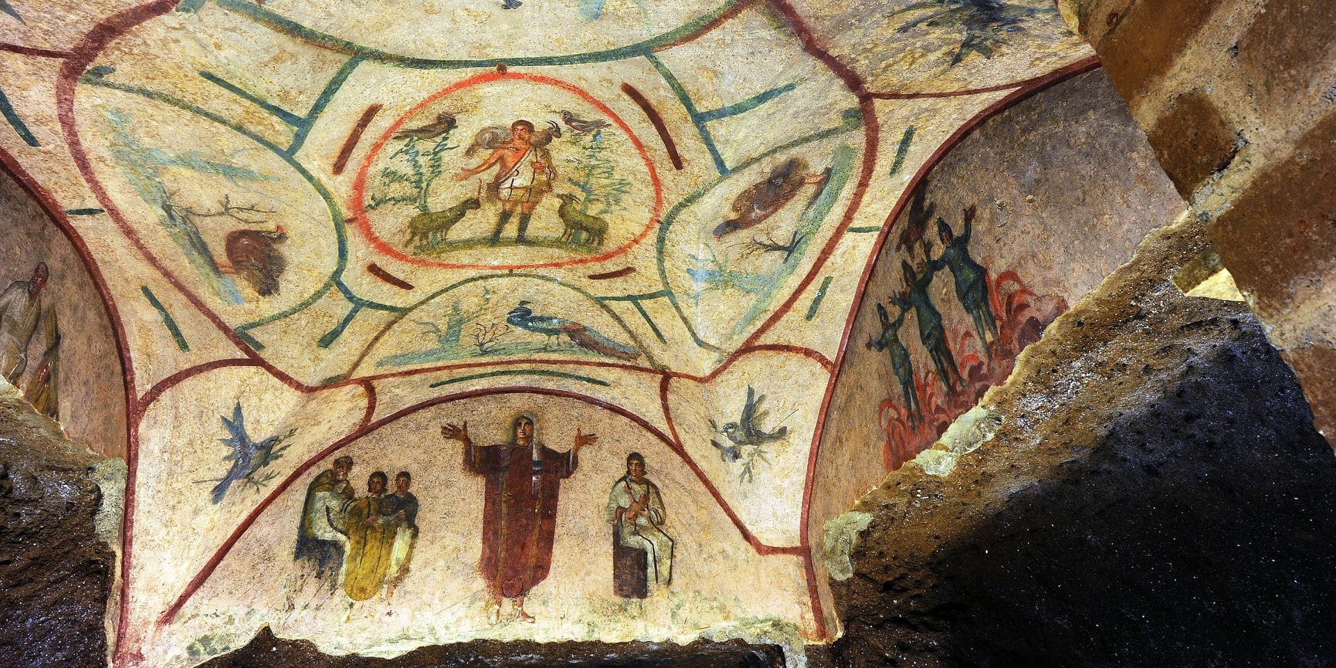 View of a frescoe said by some to show woman priest in the early Christian church in the Catacombs of Priscilla in Rome, Italy on May 2014. After years of restoration, the Vatican a few months ago unveiled the new frescoes in the Catacombs of Priscilla, Rome. The catacombs were used for early Christians burials from the late 2nd - 4th Century. The labyrinthine cemetery complex stretching for 13 kilometers over several levels underneath northern Rome is known as the 'Queen of the catacombs' because it features burial chambers of popes and a tiny, delicate fresco of the Madonna nursing Jesus dating from around 230-240 A.D., the earliest known image of the Madonna and Child. More controversially, the catacomb tour features two scenes said by proponents of the women's ordination movement to show women priests: One in the ochre-hued Greek Chapel features a group of women celebrating a banquet, said to be the banquet of the Eucharist. Another fresco in a richly decorated burial chamber features a woman, dressed in a dalmatic ? a cassock-like robe ? with her hands up in the position used by priests for public worship. The Association of Roman Catholic Women Priests holds the images up as evidence that there were women priests in the early Christian church ? and that therefore there should be women priests today. But the Vatican has dismissed them as pure 'fable, a legend'. Lost for centuries after its entrances were sealed in ancient time, the catacombs were re-discovered in the 16th century and plundered of many gravestones, sarcophagi and bodies. Excavations in modern times began in the 19th century. The museum presents 700 fragments of finely sculpted marble sarcophaguses that were discovered buried in the catacombs of Priscilla in 1890. The Priscilla catacombs are being featured in a novel blending of antiquity and modern-technology: For the first time, Google Maps has gone into the Roman catacombs, providing a virtual tour of the Priscilla complex available to anyon