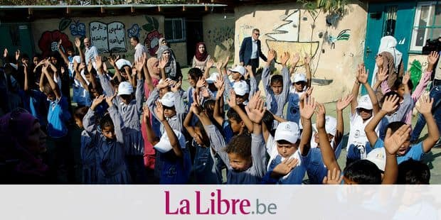 Palestinian children line up at the start of the new school year, in the West Bank Bedouin community of Khan al-Ahmar, Monday, July 16, 2018. The Palestinian ministry of education has decided to start the school-year early in the village in that is slated for demolition. The ministry says it's trying to pre-empt any Israeli move by starting school early for 170 elementary students in Khan al-Ahmar and four nearby Bedouin communities. AP Photo/Nasser Nasser)