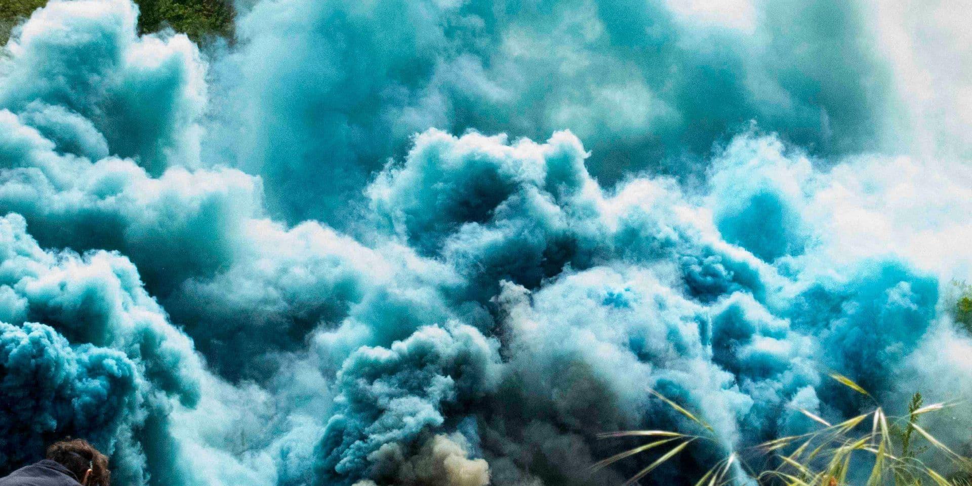 Hicham Berrada , Celeste, 2014 Color photograph 40 x 50 cm Grey sky, sky blue smoke