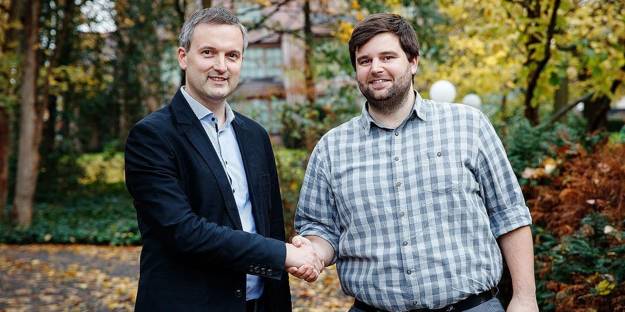 Geert Asman and Brent Meuleman shake hands after a press conference to present a new coalition for the Zelzate municipality, Saturday 10 November 2018. BELGA PHOTO KURT DESPLENTER