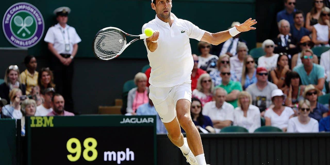 Novak Djokovic of Serbia celebrates defeating Kei Nishikori of Japan during their men's quarterfinal match at the Wimbledon Tennis Championships in London, Wednesday July 11, 2018. (AP Photo/Kirsty Wigglesworth)