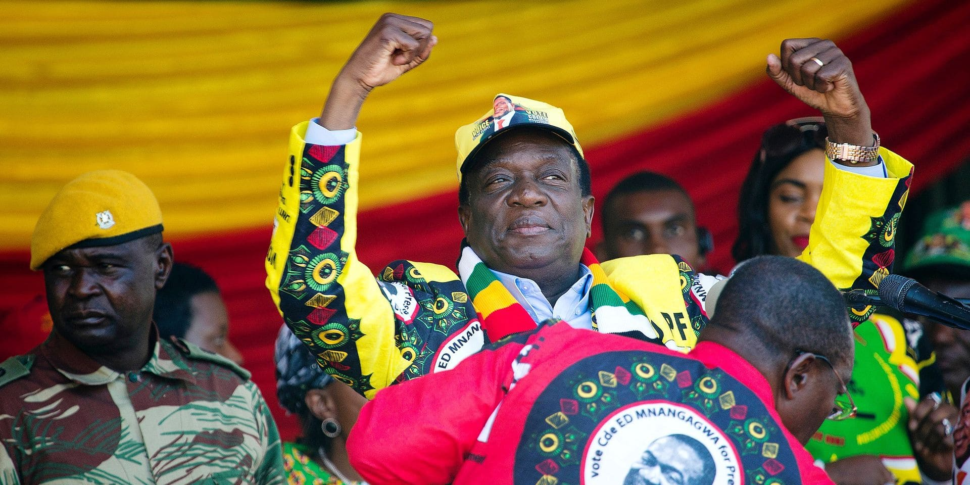 """Zimbabwean President Emmerson Mnangagwa addresses the final rally of his campaign at the stadium in Harare, Zimbabwe, Saturday July 28, 2018. Zimbabwean President Emmerson Mnangagwa has promised a """"thunderous victory"""" as he and main challenger Nelson Chamisa rally supporters one last time ahead of Monday's election. (AP Photo/Jerome Delay)"""